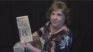 Betty Barton shares a newspaper clipping about the Dallas parades during her oral history interview.