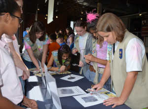 Girl Scouts study evidence at CSI Day