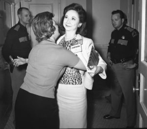 Columnist Dorothy Kilgallen smiles as she is searched prior to entering the courtroom. Bill Winfrey Collection, The Dallas Morning News/The Sixth Floor Museum at Dealey Plaza