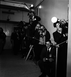 Cameramen gather in the courthouse hallway. Note the lights and camera taped to the wall. Bill Winfrey Collection, The Dallas Morning News/The Sixth Floor Museum at Dealey Plaza