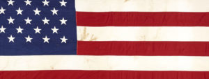 The flag that flew over the Senate Wing of the U.S. Capitol Building during the mourning period after the death of President John F. Kennedy