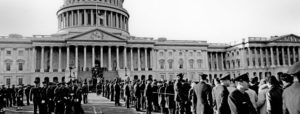 Mourners waiting outside to view President Kennedy's casket at the U.S. Capitol Rotunda stand in the lines that reach three miles long.