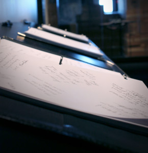Pages of Memory Book binders display visitors' handwritten thoughts and reflections at The Sixth Floor Museum.