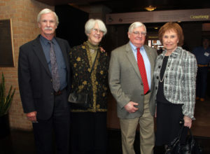 This group photo features (from left to right): Visitors Center architect Jim Hendricks, Sixth Floor exhibit designers Barbara Charles and Bob Staples, and Nancy Cheney (on the right) commemorating The Sixth Floor Museum's 20th anniversary in February 2009.