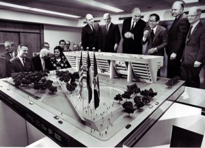 A model of the new Dallas City Hall is inspected by architect Harris Kemp (standing, from left), City Manager Scott McDonald, Mayor Erik Jonsson, and Architects I. M. Pei, Easton H. Leonard and Terrell Harper as City Council members look on Tuesday, April 22. The model will be displayed in the present City Hall lobby.