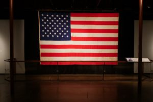The U.S. Senate wing flag is displayed on the seventh floor of The Sixth Floor Museum at Dealey Plaza.