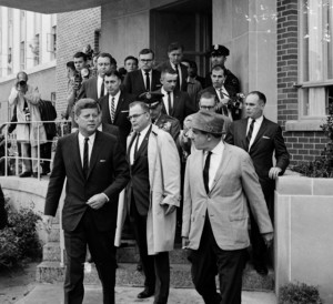 Press surround President Kennedy during a brief visit to Dallas on October 9, 1961.